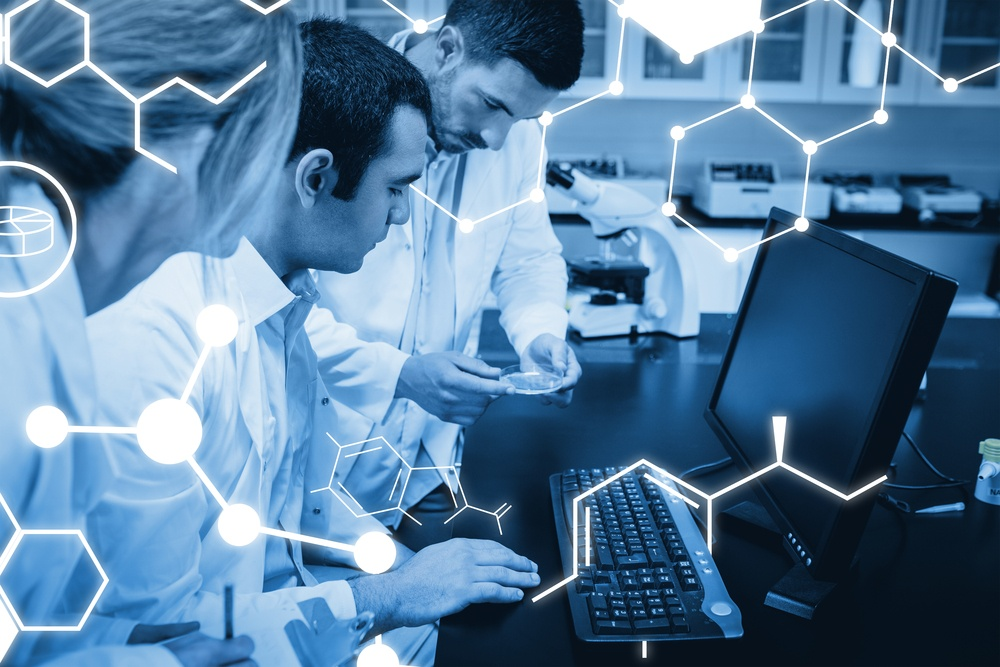 Science graphic against science students working together in the lab.jpeg