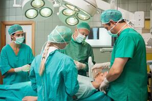 Surgery team working together in a surgical room.jpeg