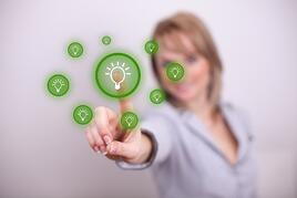Woman pressing idea button with one hand