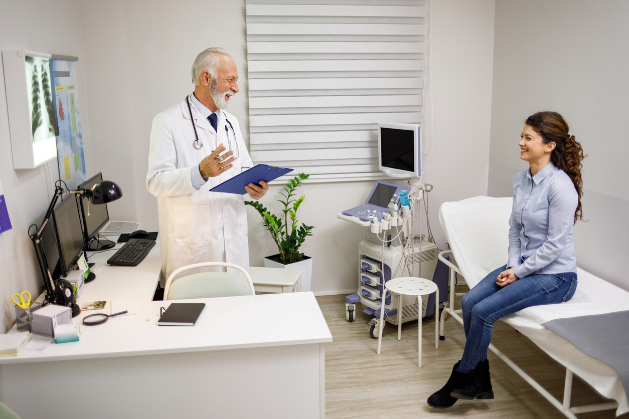 Experienced doctor explaining x-ray results to a female patient