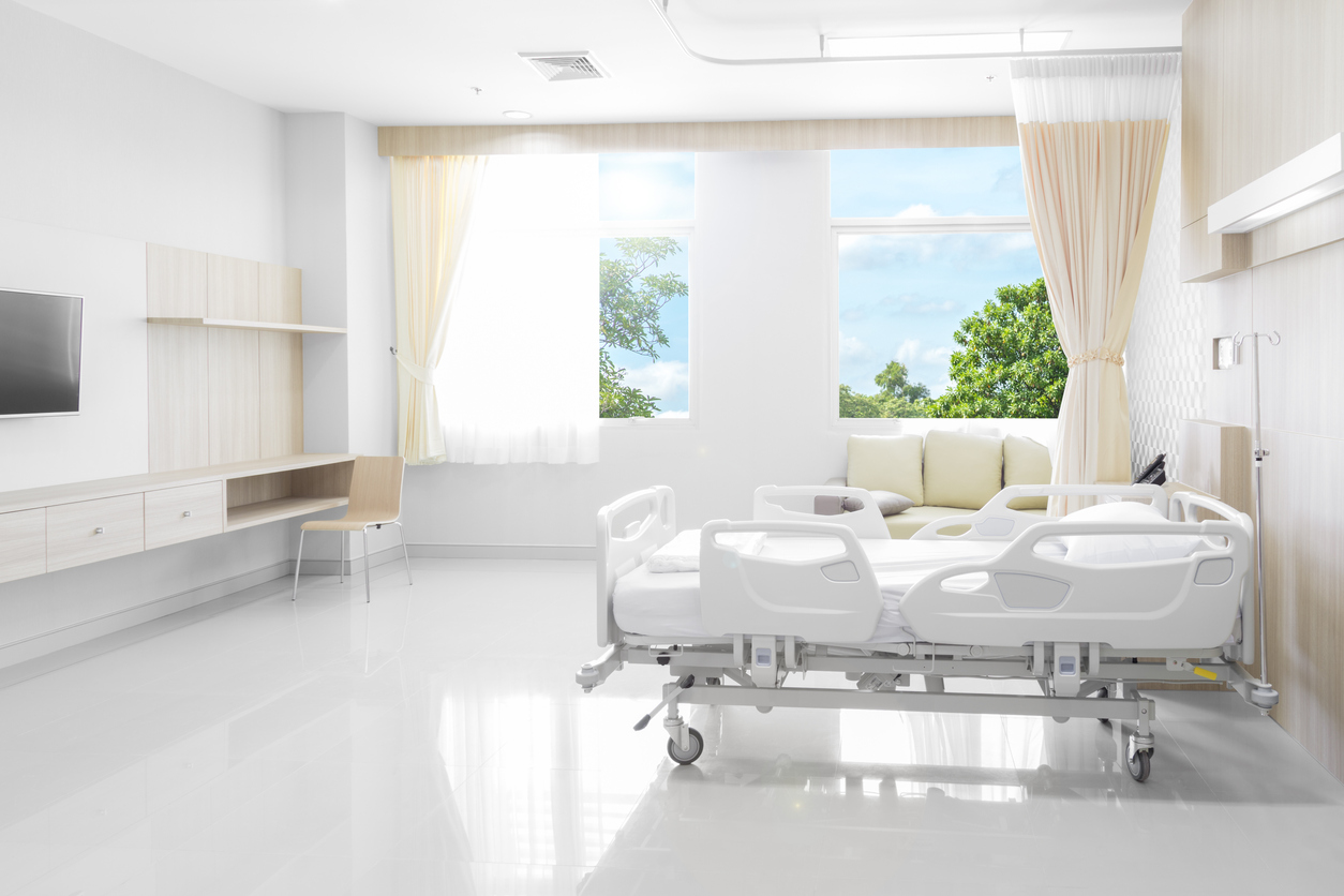 Hospital room with beds and comfortable medical equipped with natural background
