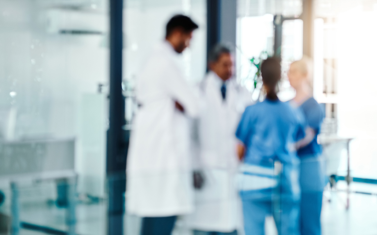 Defocused shot of a group of medical practitioners working in a hospital