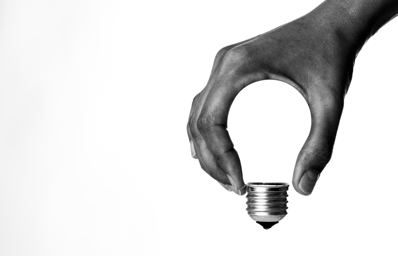Light bulb in human hand, b&w.