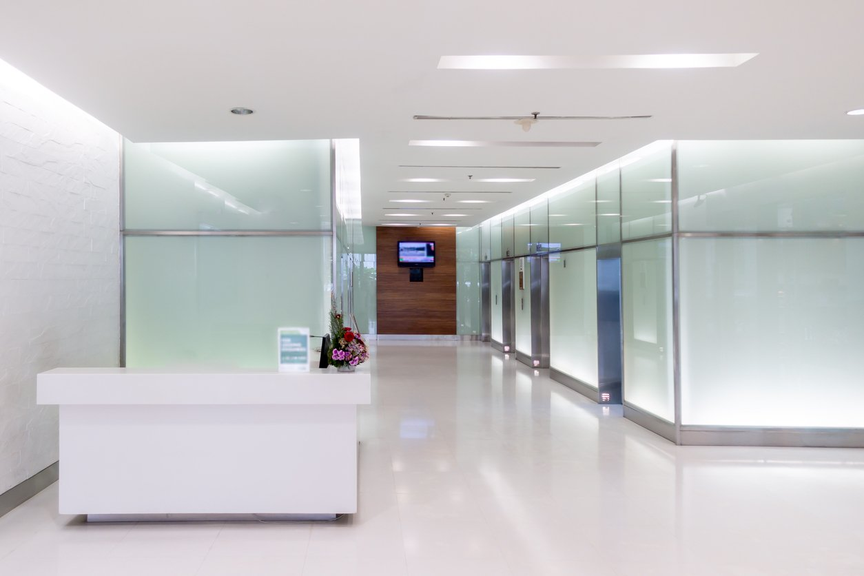 Background image the clean reception counter at front of six elevators in hospital hall