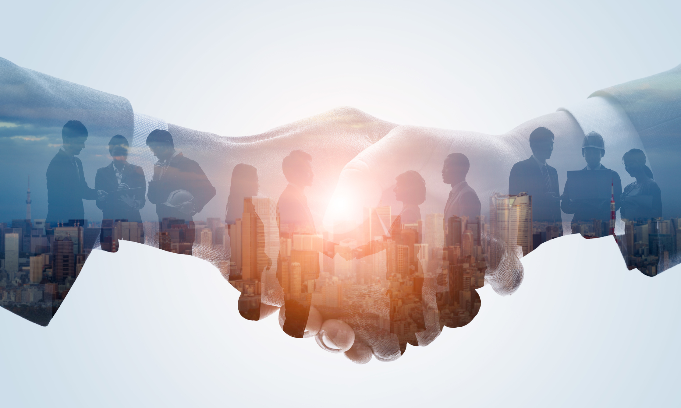 close up of business professionals linking hands